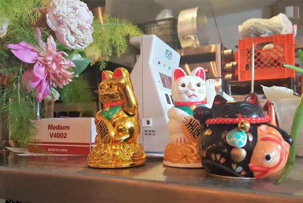 Aubergine Bistro's Maneki-nekos aka good luck cats wave goodbye to loyal patrons.